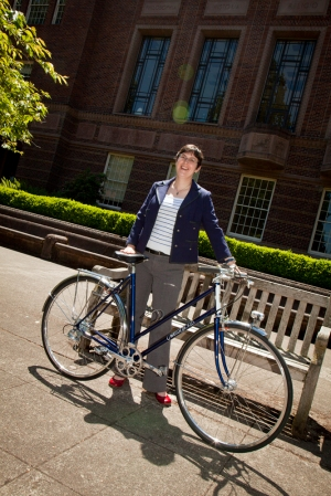 Karen Estlund with Winter Bicycle in front of Knight Library